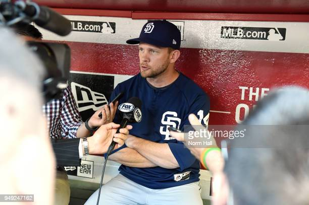 Manager Andy Green of the San Diego Padres talks with the media in the dugout prior to a game against the Arizona Diamondbacks at Chase Field on...