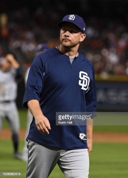 Manager Andy Green of the San Diego Padres walks back to the dugout after making a mound visit during the sixth inning against the Arizona...