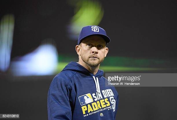 Manager Andy Green of the San Diego Padres walks back to the dugout after making a pitching change against the San Francisco Giants in the bottom of...