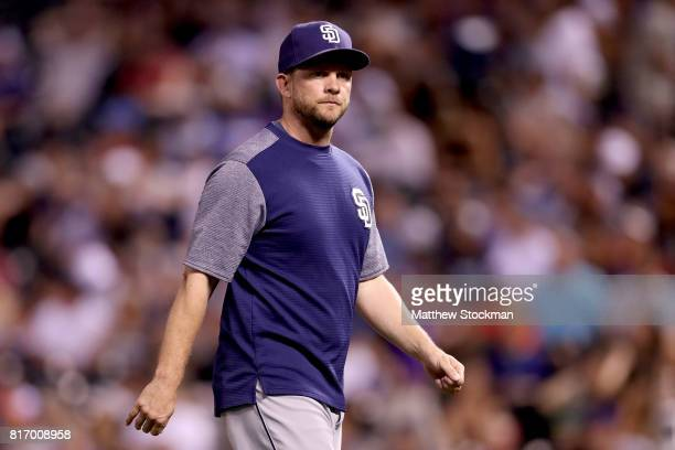 Manager Andy Green of the San Diego Padres walks back to the dugout after changing pitchers in the eighth inning against the Colorado Rockies at...