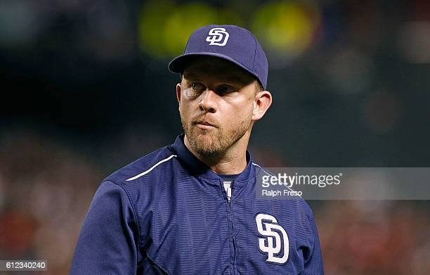Manager Andy Green of the San Diego Padres walks from the mound after a pitching change against the Arizona Diamondbacks during the seventh inning of...