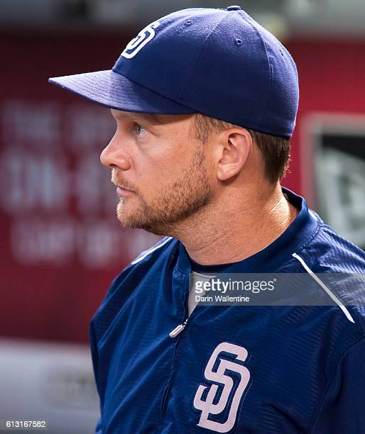 Manager Andy Green of the San Diego Padres watches the video board before the MLB game between the San Diego Padres and Arizona Diamondbacks at Chase...