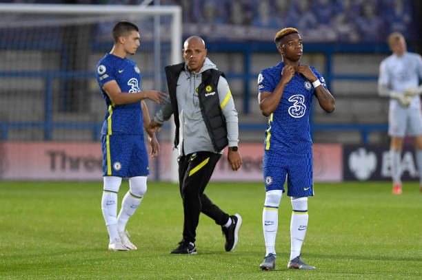 Manager Andy Myers and Charly Musonda of Chelsea during the Premier League 2 match between Chelsea and Liverpool on September 24, 2021 in Kingston...