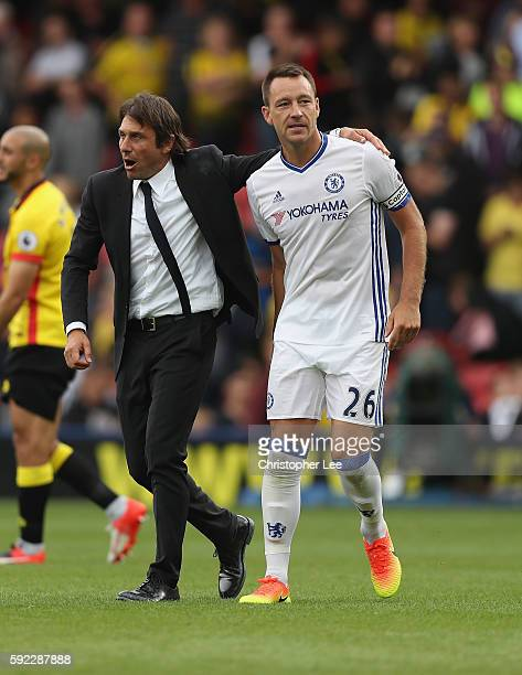 Manager Antonio Conte and John Terry of Chelsea celebrate their victory during the Premier League match between Watford and Chelsea at Vicarage Road...
