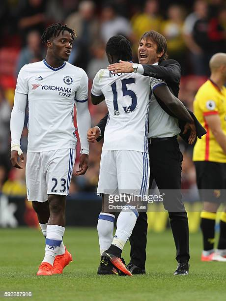 Manager Antonio Conte and Victor Moses of Chelsea celebrate their victory during the Premier League match between Watford and Chelsea at Vicarage...
