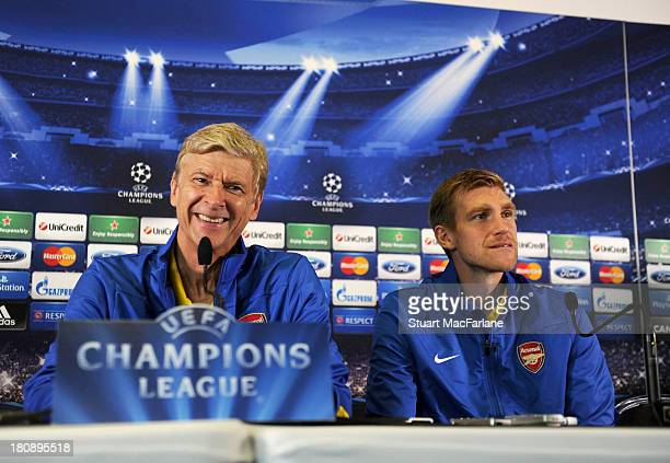 Manager Arsene Wenger and defender Per Mertesacker of Arsenal attend a press conference at Stade Velodrome on September 17, 2013 in Marseille, .
