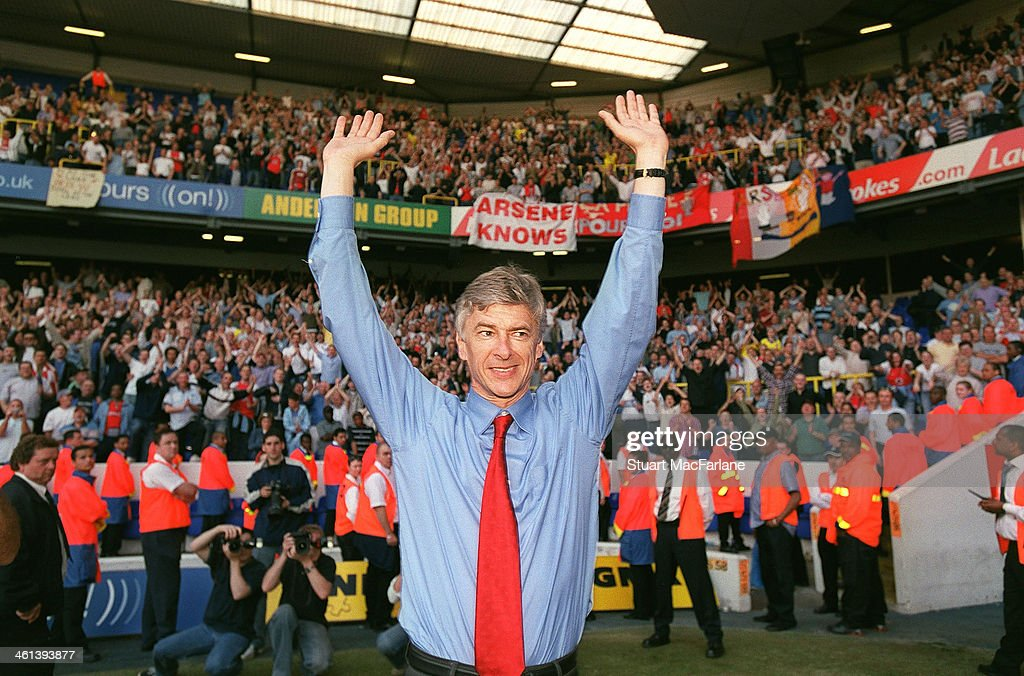 Manager Arsene Wenger celebrates Arsenal winning the Premier League after the match between Tottenham and Arsenal at White Hart Lane on April 25, 2004 in London, England.