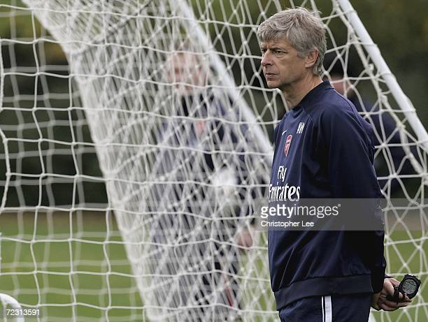 Manager Arsene Wenger looks on during the Arsenal training session at their London Colney training ground on October 31 2006 in London Colney England