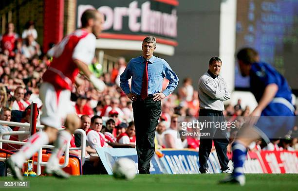 Manager Arsene Wenger of Arsenal and Micky Adams of Leicester City watch the FA Barclaycard Premiership match between Arsenal and Leicester City at...