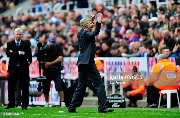 Manager Arsene Wenger of Arsenal celebrates at the final whistle during the Barclays Premier League match between Newcastle United and Arsenal at St...