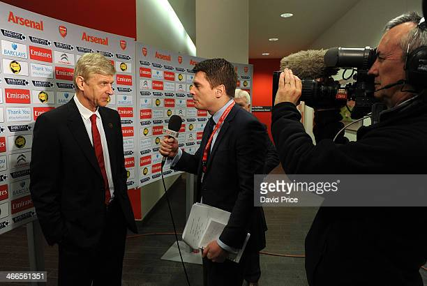 Manager Arsene Wenger of Arsenal is interviewed before the Barclays Premier League match between Arsenal and Crystal Palace at Emirates Stadium on...