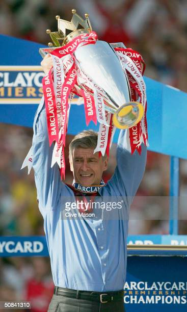 Manager Arsene Wenger of Arsenal lifts the Premiership trophy during the FA Barclaycard Premiership match between Arsenal and Leicester City at...