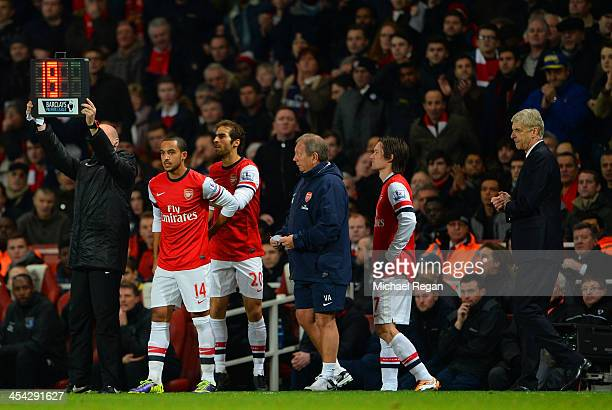 Manager Arsene Wenger of Arsenal looks on as he makes a triple substitution of Theo Walcott Mathieu Flamini and Tomas Rosicky of Arsenal during the...