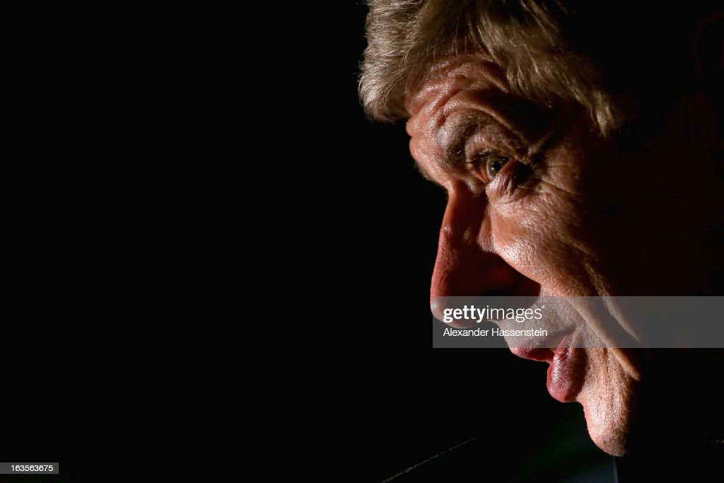 Manager Arsene Wenger of Arsenal looks on during a Arsenal FC press conference ahead of their UEFA Champions League round of 16 match against Bayern Muenchen at Allianz Arena on March 12, 2013 in Munich, Germany.