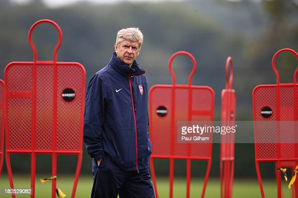 Manager Arsene Wenger of Arsenal looks on during an Arsenal training session ahead of their Champions League Group F match against Napoli at London...
