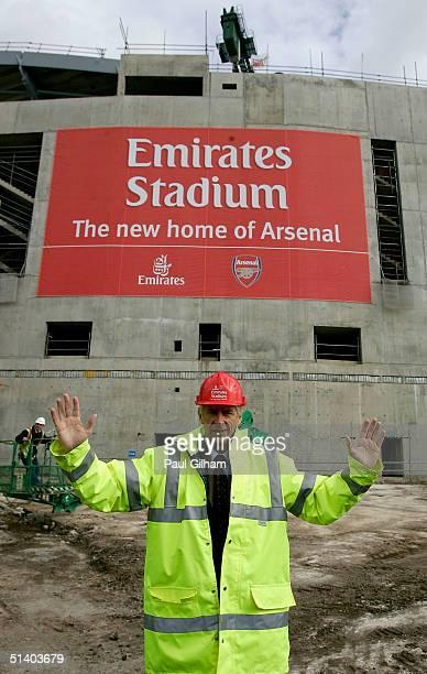 Manager Arsene Wenger of Arsenal poses outside Arsenal Football Club's new Emirates Stadium development at Ashburton Grove on October 5, 2004 in...