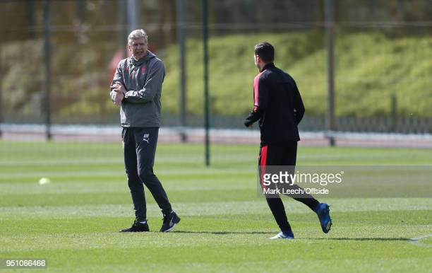 Manager Arsene Wenger welcomes Mesut Ozil during Arsenal Training at London Colney on April 25 2018 in St Albans England