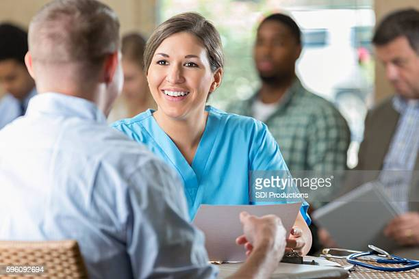 manager at hospital  interviewing potential nursing staff healthcare worker - interview event stock pictures, royalty-free photos & images