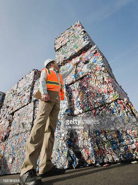 manager at recycling plant - aluhut stock-fotos und bilder