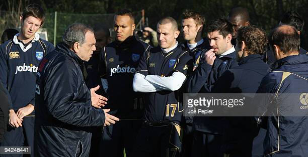 Manager, Avram Grant speaks with his players during a Portsmouth FC training session at their Eastleigh training ground on December 10, 2009 in...