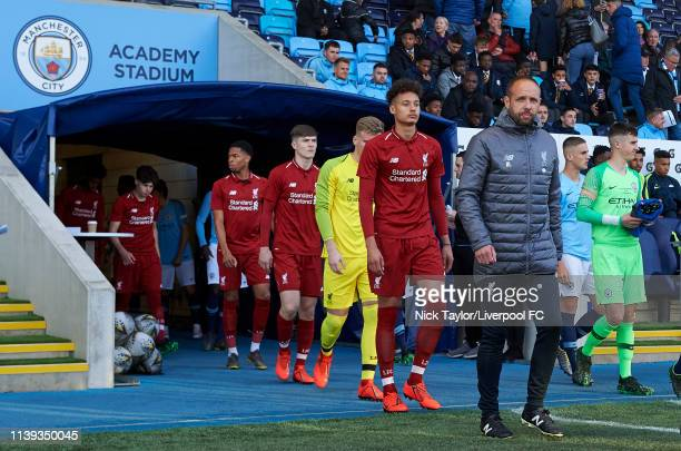 U18 manager Barry Lewtas of Liverpool leads his team to the pitch before the FA Youth Cup Final at Manchester City Football Academy on April 25 2019...
