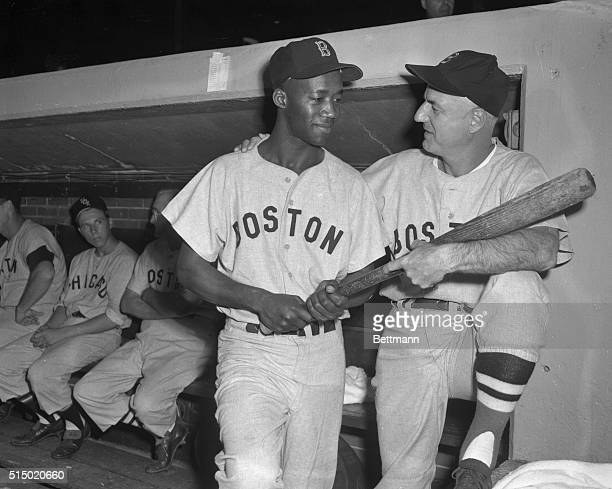 Manager Bill Jurges of the Boston Red Sox greets Pumpsie Green who was recalled to the parent club from Minneapolis Green an infielder became the...