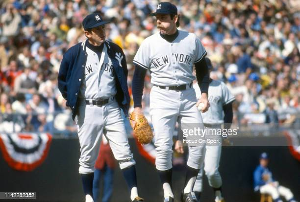 Manager Billy Martin of the New York Yankees comes out to talk with his pitcher Sparky Lyle against the Kansas City Royals in Game 4 of the ALCS...