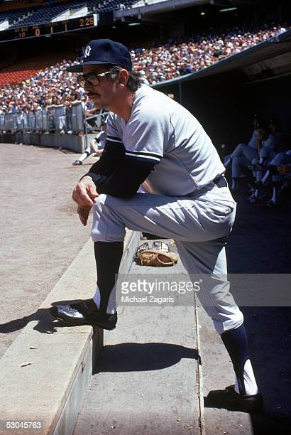 Manager Billy Martin of the New York Yankees watches the action from the steps of the dugout during a game circa July of 1979