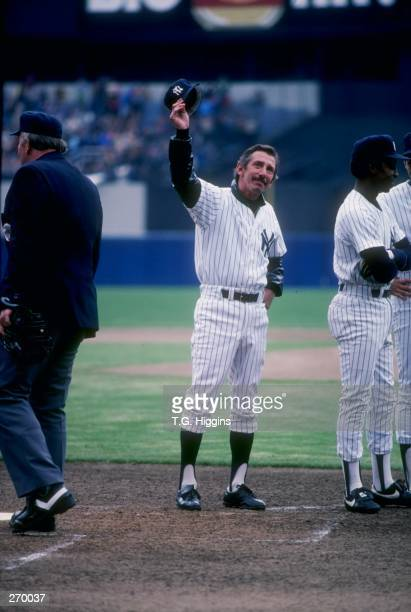 Manager Billy Martin of the New York Yankees waves to the crowd at Yankee Stadium in the Bronx New York