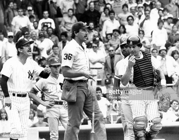 Manager Billy Martin of the New York Yankees yells at umpire Tim McClelland to check the bat used by George Brett of the Kansas City Royals after...