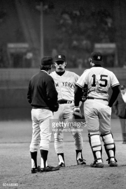 """Manager Billy Martin, relief pitcher Albert """"Sparky"""" Lyle and catcher Thurman Munson of the New York Yankees talk on the mound during a game against..."""