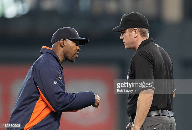 Manager Bo Porter of the Houston Astros argues a close call at first base with umpire Chris Conroy during a game against the Texas Rangers at Minute...