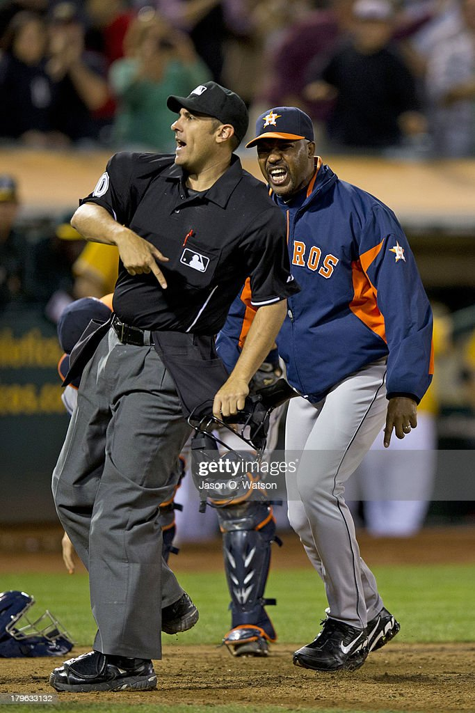 Manager Bo Porter #16 of the Houston Astros is ejected by home plate umpire Mark Ripperger #90 after arguing a call in which Stephen Vogt of the Oakland Athletics (not pictured) was called safe at home plate during the eighth inning at O.co Coliseum on September 5, 2013 in Oakland, California.