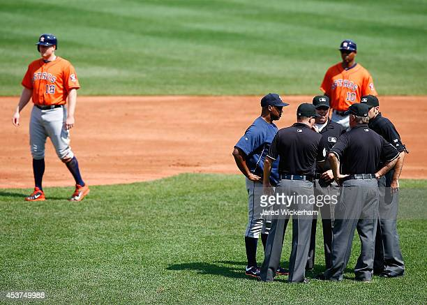 Manager Bo Porter of the Houston Astros talks with umpires following a double play call at second base againt the Boston Red Sox during the game at...