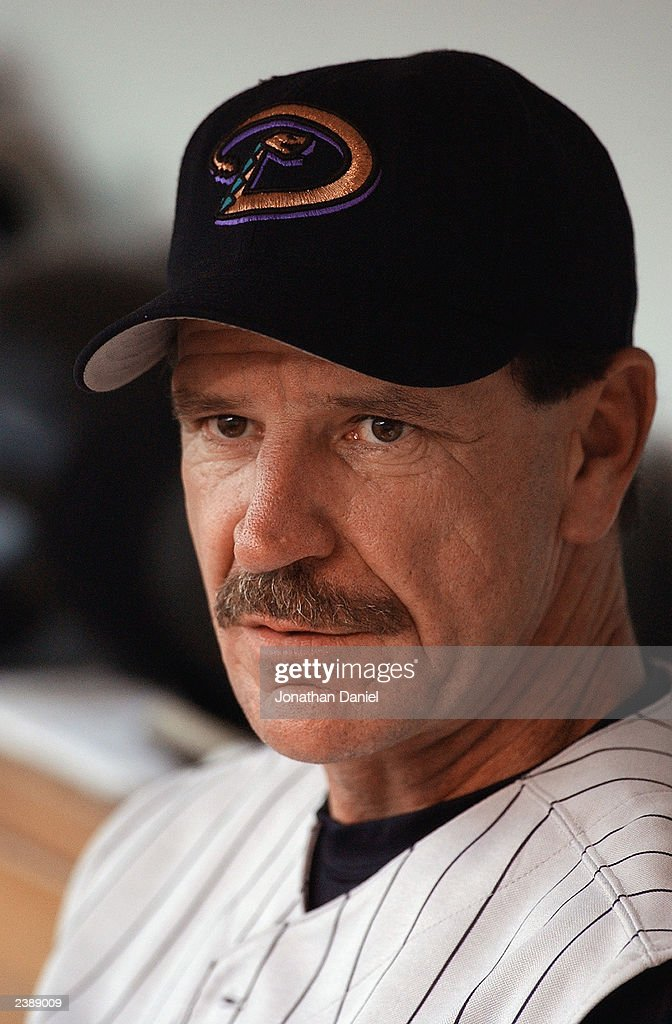 Manager Bob Brenly of the Arizona Diamondbacks sits in the dugout during the National League game against the Chicago Cubs at Wrigley Field on August 1, 2003 in Chicago, Illinois. The Cubs won 4-3.
