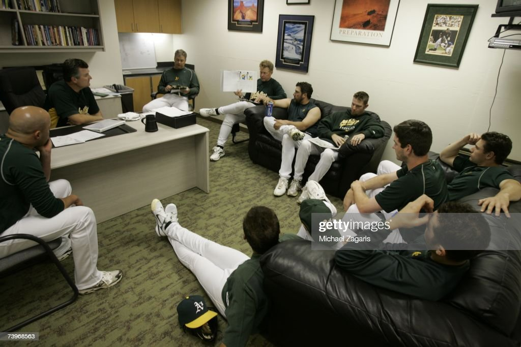 Manager Bob Geren and Curt Young of the Oakland Athletics conduct a pitchers' meeting in the clubhouse before the game against the Chicago White Sox on MLB Opening Night at the McAfee Coliseum in Oakland, California on April 9, 2007. The White Sox defeated the Athletics 4-1.