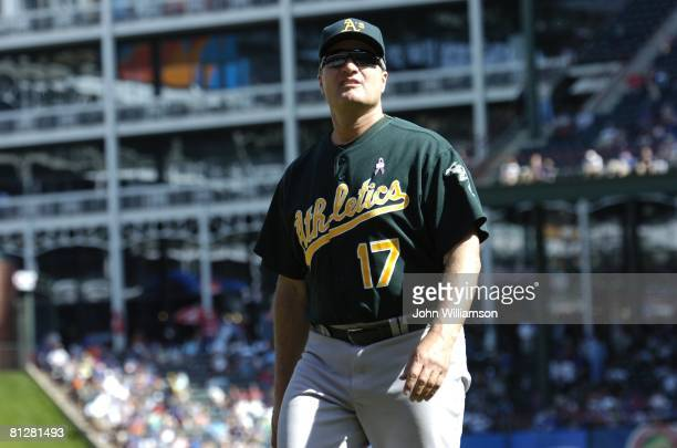 Manager Bob Geren of the Oakland Athletics looks off the field as he walks to the dugout from the pitcher's mound after making a pitching change...