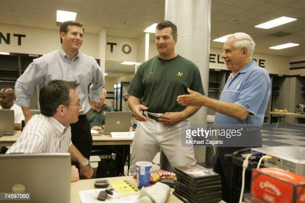 Manager Bob Geren of the Oakland Athletics talks with Manager Billy Beane, Assistant General Manager David Forst and Owner Lew Wolff in the draft...
