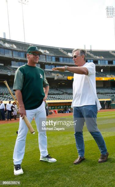 Manager Bob Melvin and Executive Vice President of Baseball Operations Billy Beane of the Oakland Athletics talk on the field after first round draft...