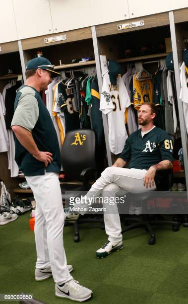 Manager Bob Melvin and John Axford of the Oakland Athletics talk in the clubhouse prior to the game against the Boston Red Sox at the Oakland Alameda...