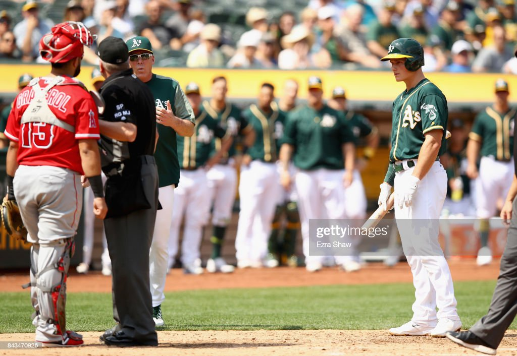 Manager Bob Melvin argues with home plate umpire Mike Everitt after Matt Chapman #26 of the Oakland Athletics was ejected from the game after having words with Juan Graterol #13 of the Los Angeles Angels in the fourth inning at Oakland Alameda Coliseum on September 6, 2017 in Oakland, California.