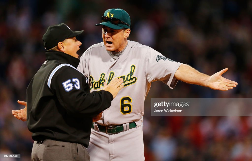 Manager Bob Melvin #6 of the Oakland Athletics argues with first base umpire Greg Gibson in the ninth inning on a foul ball call against the Boston Red Sox during the game on April 24, 2013 at Fenway Park in Boston, Massachusetts.