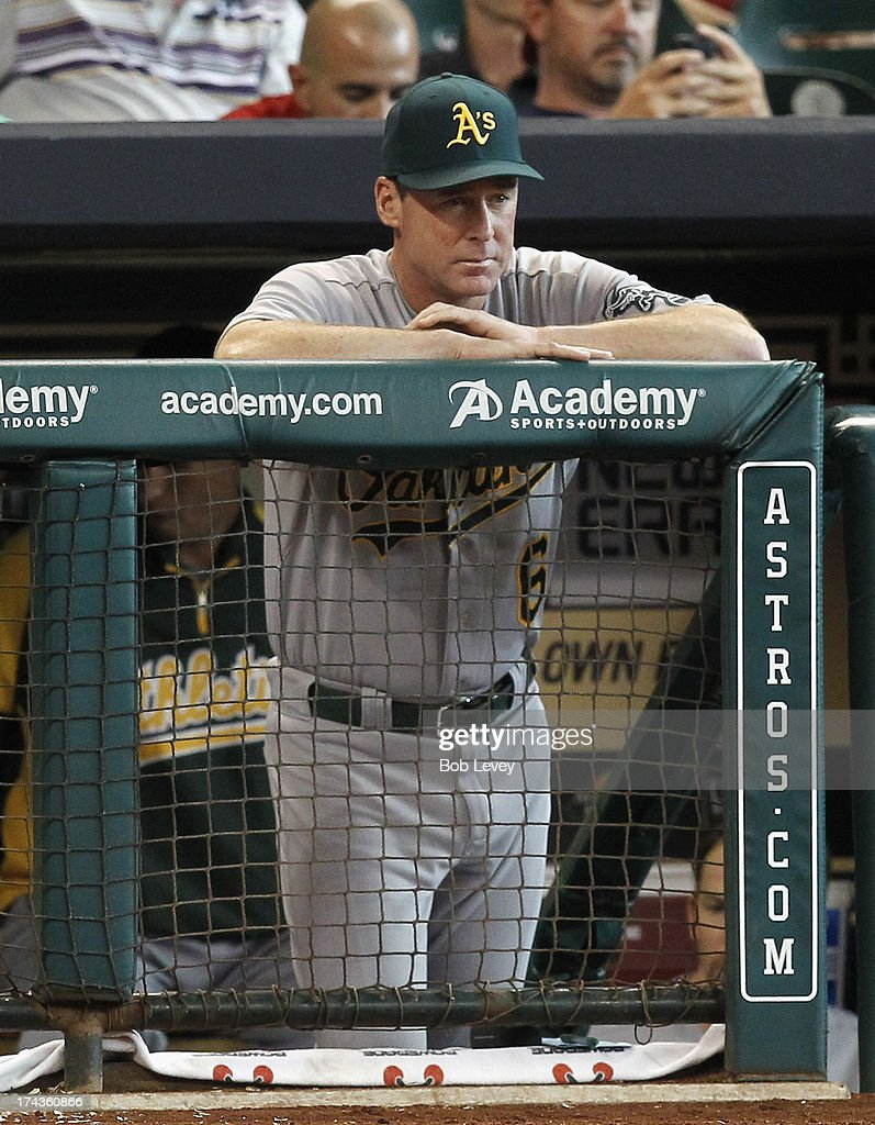 Manager Bob Melvin of the Oakland Athletics looks from the dugout during a baseball game against the Houston Astros at Minute Maid Park on July 24, 2013 in Houston, Texas.