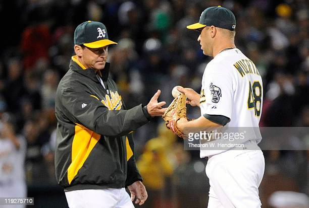 Manager Bob Melvin of the Oakland Athletics takes the ball from pitcher Michael Wuertz after Wuertz walked in a run against the Los Angeles Angels of...