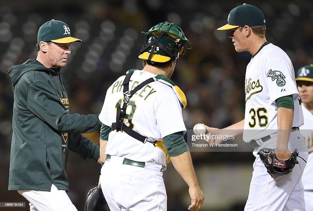 Manager Bob Melvin #6 of the Oakland Athletics takes the ball from starting pitcher Aaron Brooks #36 taking him out of the game against the Seattle Mariners in the top of the third inning at O.co Coliseum on September 4, 2015 in Oakland, California.