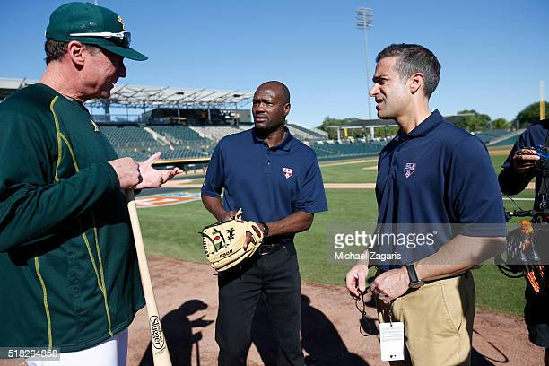 Manager Bob Melvin of the Oakland Athletics talks talks with Harold Reynolds and Matt Vasgersian prior to a spring training game against the Los...