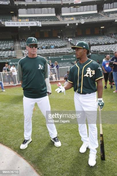 Manager Bob Melvin of the Oakland Athletics talks with first round draft pick Kyler Murray on the field after Murray signed his contract with the...