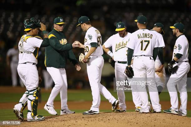 Manager Bob Melvin takes Andrew Triggs of the Oakland Athletics out of the game after he gave up a threerun triple to Jim Adduci of the Detroit...