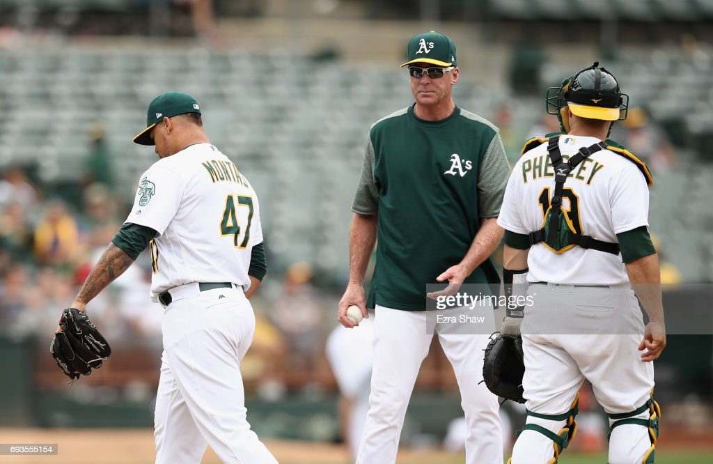 Manager Bob Melvin takes out Frankie Montas #47 of the Oakland Athletics after he gave up two home runs in the 10th inning against the Toronto Blue Jays at Oakland Alameda Coliseum on June 7, 2017 in Oakland, California.