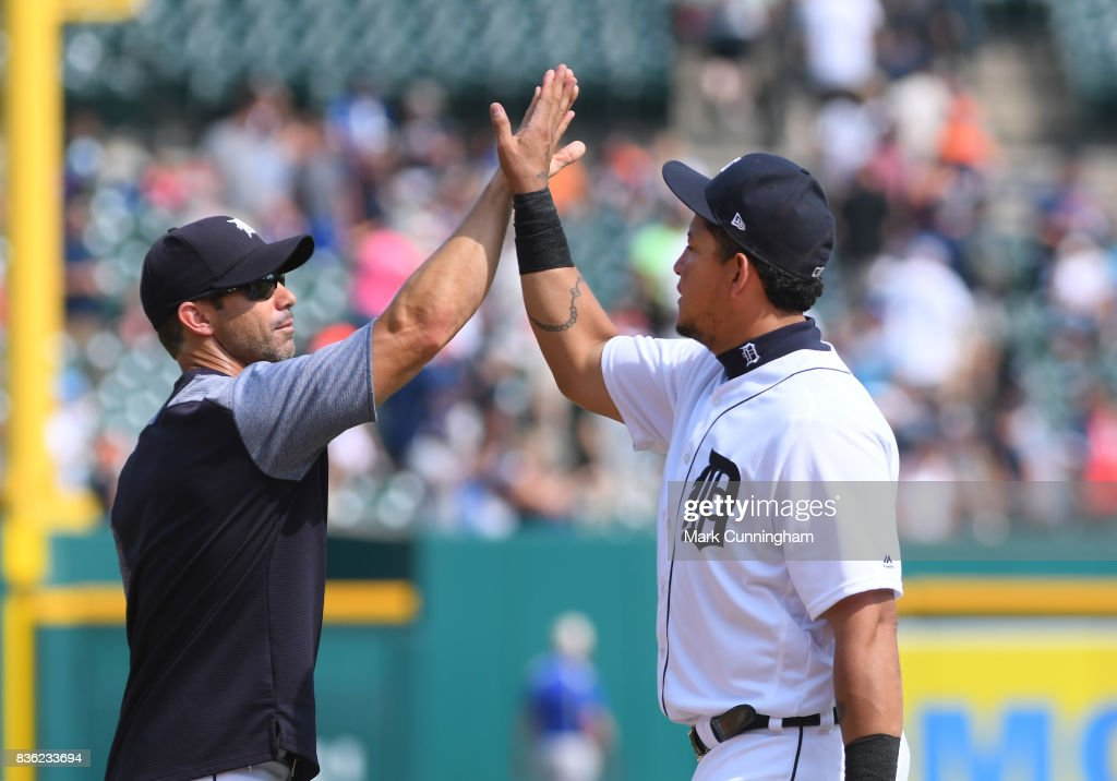 Manager Brad Ausmus #7 (L) and Miguel Cabrera #24 of the Detroit Tigers high-five to celebrate the victory against the Los Angeles Dodgers at Comerica Park on August 20, 2017 in Detroit, Michigan. The Tigers defeated the Dodgers 6-1.